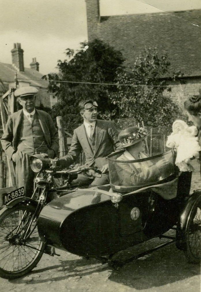Robert & Marie Budd with new granddaughter at rear of Old Nursery 1923