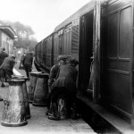 Loading milkchurns at Selham station 1923