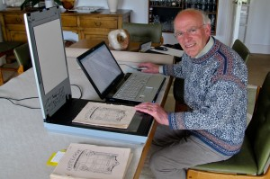 Tony Brooks scanning early editions of our parish magazine Outlook